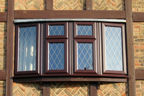 Rosewood effect window with diamond lead