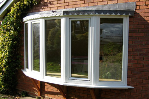 White UPVc bay window with lead roof